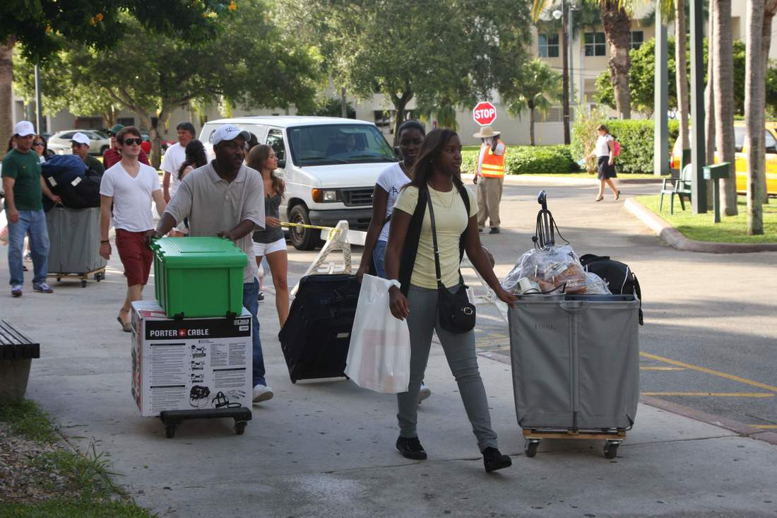 Photo of college students moving into dorm