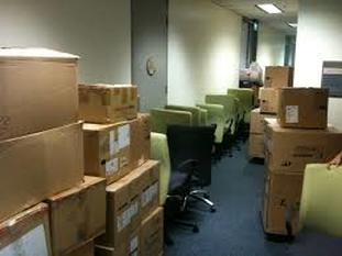 Photo of Packed Boxes in Hallway